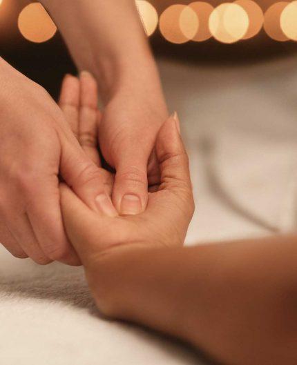 spa-therapist-massaging-african-lady-hand-closeup