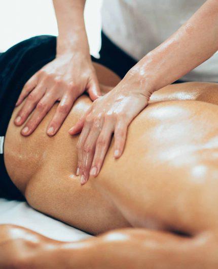 sports-massage-therapist-massaging-lower-back
